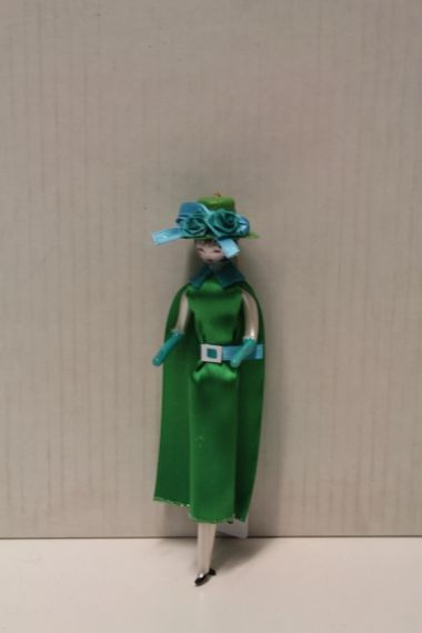 LADY WITH GREEN DRESS AND GREEN HAT