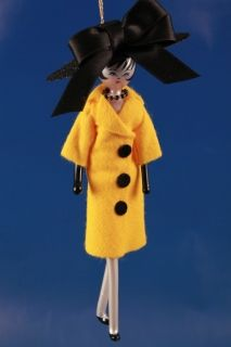 LADY IN YELLOW COAT AND BLACK HAT