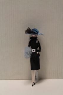 LADY IN A BLACK COAT AND A BLACK HAT