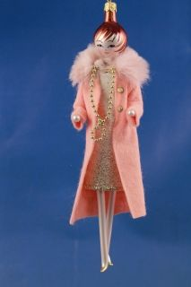 LADY WITH A PINK COAT AND A GOLDEN NECKLACE