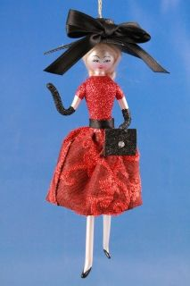 LADY IN A RED DRESS AND A BLACK BAG